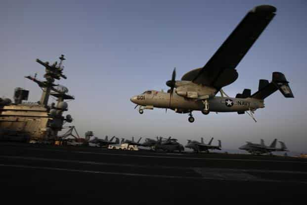 A file photo shows an aircraft landing after missions targeting the Islamic State group in Iraq from the deck of the US Navy aircraft carrier USS George H.W. Bush in the Persian Gulf. Photo: AP