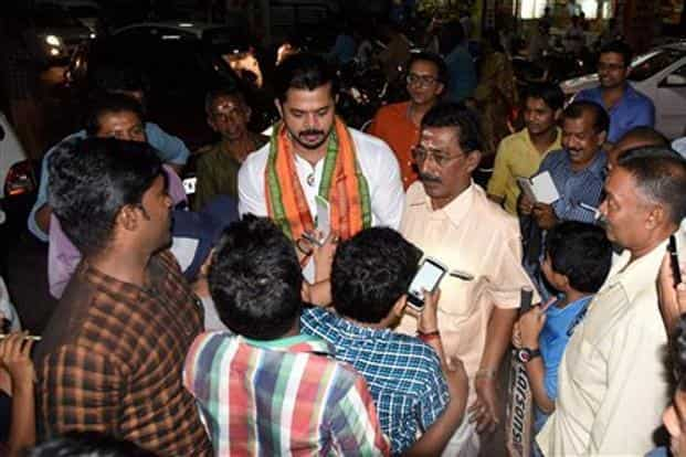 Former Indian cricketer S. Sreesanth, the BJP candidate for Thiruvananthapuram constituency in the upcoming Kerala assembly polls meets people after offering prayers at the Sreekanteswaram Temple in Thiruvananthapuram. Photo: PTI