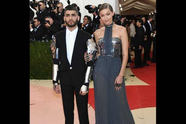Gigi Hadid's (right) gunmetal Tommy Hilfiger see-through gown worked well for the theme but Zayn Malik went with it too literally, wearing metal plates by Versace on the arms of his tuxedo. AFP