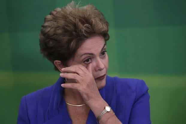 Brazil's President Dilma Rousseff is to face trial after the Senate voted to impeach and suspend her. Photo: Ueslei Marcelino/Reuters