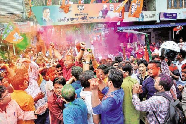 BJP workers celebrate the party's victory in the Assam assembly election at Hengrabari in Guwahati on Thursday. Photo: PTI