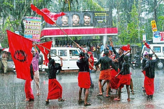 Kozhikode: Rain is no deterrent for LDF workers celebrating their win. Photo: PTI