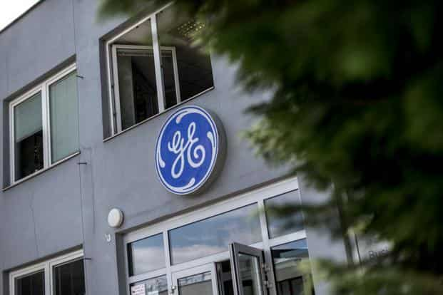The 124-year-old GE, one of the original dozen members of the Dow Jones Industrial Average, has long been a trendsetter. Its management ideas are taught at business schools, and its executives have moved on to head other major companies. Photo: Bloomberg