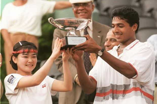 The 16th seed pair of Rika Hiraki and Mahesh Bhupathi (right) won the French Open mixed doubles final on 7 June 1997. Photo: Jean-Loup Gautreau/AFP