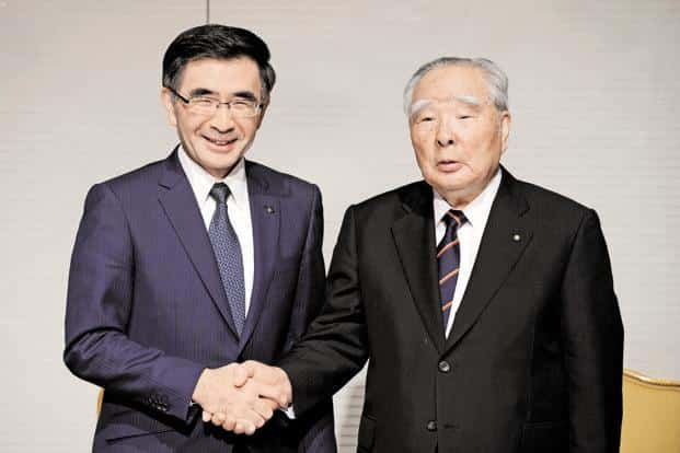 Toshihiro Suzuki (left) with Osamu Suzuki. Osamu Suzuki, who has quit as the CEO in light of the mileage scandal, drove India's small car dream for more than 30 years the firm has been present here. Photo: Bloomberg