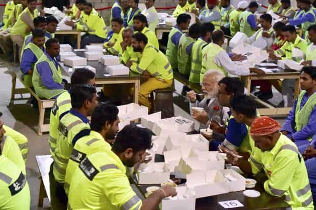 PM Narendra Modi well-publicized meal with migrant workers in Qatar during his visit to that country was a display of solidarity with Indian workers, a sort of we-are-looking-out-for-you message. Photo: PTI
