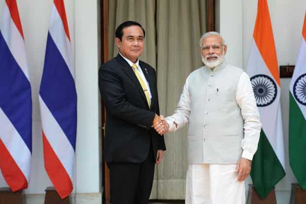 Thailand Prime Minister Prayut Chan-o-cha and Indian Prime Minister Narendra Modi shake hands ahead of a meeting in New Delhi on Friday. Photo: AFP