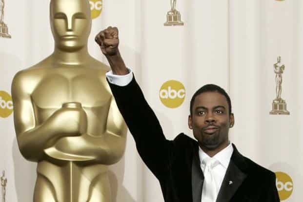 Chris Rock does the 'Black Salute' at the 77th annual Academy Awards in Hollywood, 27 February, 2005. Photo: Reuters