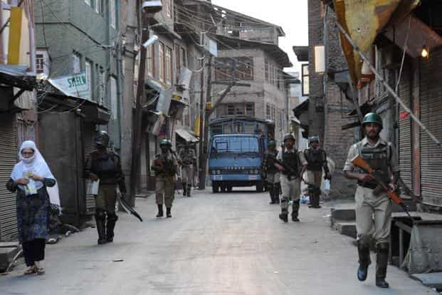 Paramilitary soldiers patrol the streets during a curfew in downtown Srinagar on 13 July. Photo: AFP