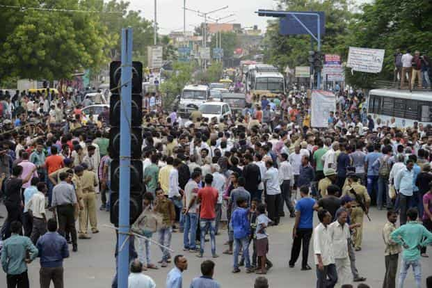 Members of the Dalit caste community protest against an earlier attack on Dalit caste members in the Gujarat town of Una, in Ahmedabad on 20 July. Photo: AFP