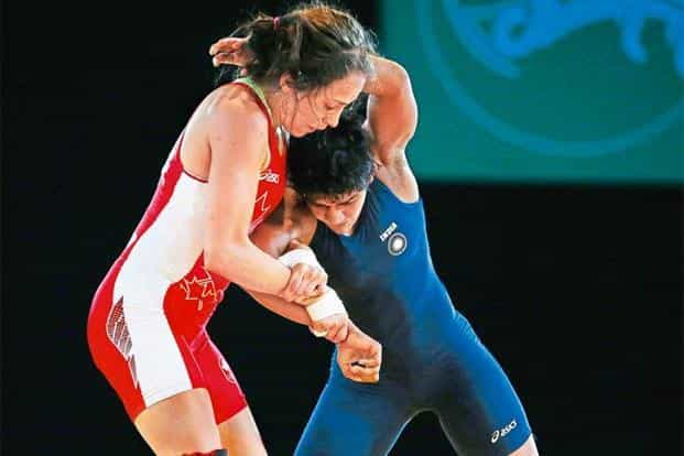 Babita Kumari (in blue). Photo: Alastair Grant/AP