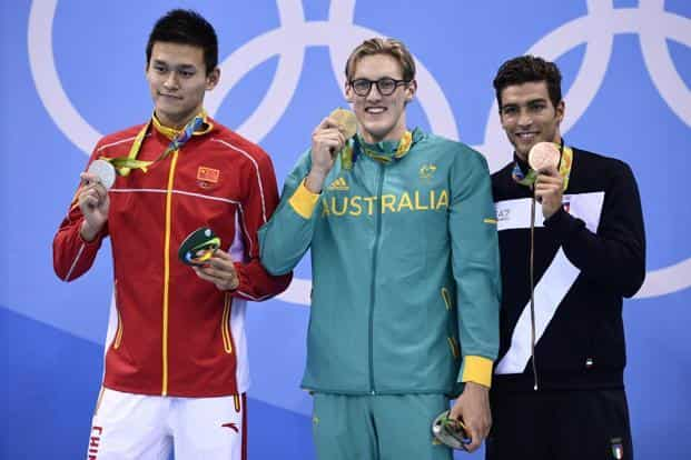 Australia's Mack Horton (C) poses on the podium with silver medallist China's Sun Yang (L) and bronze medallist Italy's Grabriele Detti after he won the Men's 400m Freestyle Final during the swimming event at the Rio 2016 Olympic Games at the Olympic Aquatics Stadium in Rio de Janeiro. Photo: AFP
