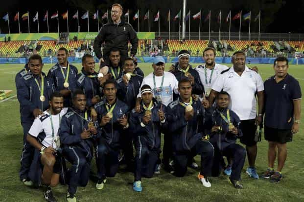 Fiji's rugby team poses for a group photograph after winning the men's rugby sevens gold medal match against Britain at the Summer Olympics in Rio de Janeiro, Brazil, on Thursday. Photo: AP
