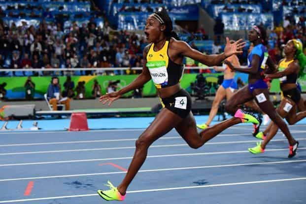 Jamaica's Elaine Thompson celebrates winning the Women's 100m final during the athletics event at the Rio Olympics. Photo: AFP