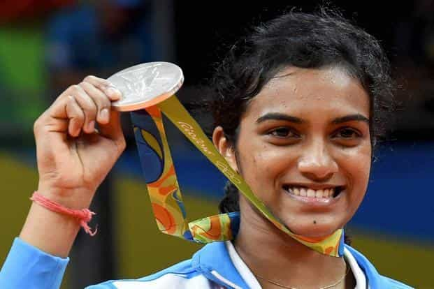India's PV Sindhu with her silver medal after her badminton final match against Spain's Carolina Marin at the 2016 Olympic Games at Rio on Friday. Photo: PTI