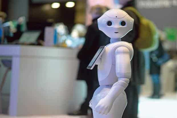 SoftBank Robotics' humanoid robot Pepper can read customers' movements, answer questions, and can learn from it all. Photo: Nigel Treblin/Reuters