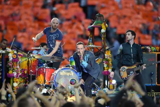 Chris Martin (centre) from Coldplay is the festival's creative director. Photo: AFP