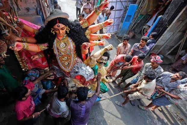 Workers pull an idol of Goddess Durga from a workshop to load it onto a truck towards a 'pandal', or a temporary platform, ahead of the Durga Puja festival in Kolkata on Wednesday. Durga Puja marks the victory of the goddess over the demon Mahishasura. The goddess fought with evil for 10 days and nine nights. The first nine days are celebrated as Navratri culminating on the 10th day as Dussehra. Rupak De Chowdhuri/Reuters