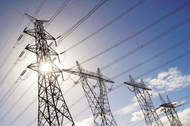 Achieving the goal of power for all by March 2019 involves not just electrifying a village, but establishing the last mile connectivity of taking power to every household. Photo: Bloomberg