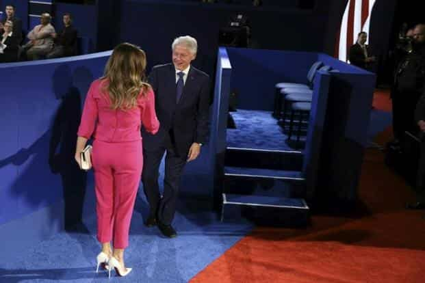 Before the debate started, a live stream on Donald Trump's Facebook page featured four women who have accused Hillary Clinton's husband and former president Bill Clinton of sexual misconduct. Bill Clinton (above right) greets Melania Trump, wife of Trump, prior to the second presidential debate. AFP