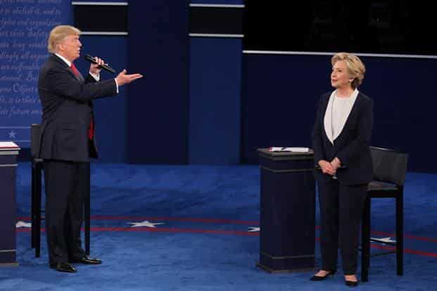 Donald Trump speaks as Hillary Clinton listens during the second US presidential debate at Washington University in St. Louis, Missouri, on 9 October. Photo: Daniel Acker/Bloomberg