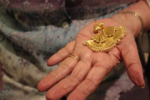 Handcrafted gold 'jhumkas'.