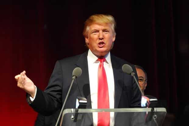 Donald Trump says he is being attacked with lies and slander. Photo: Bloomberg