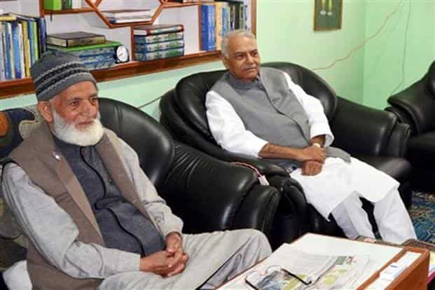Former Union finance minister Yashwant Sinha (R) with Hurriyat leader Syed  Ali Shah Geelani. Photo: PTI