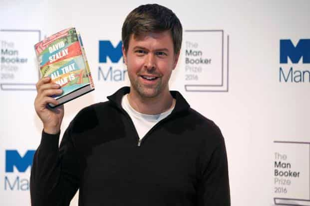 David Szalay whose collection of short stories, 'All That Man Is', was short listed for the Man Booker Prize 2016, posing with his book in London, on Monday.