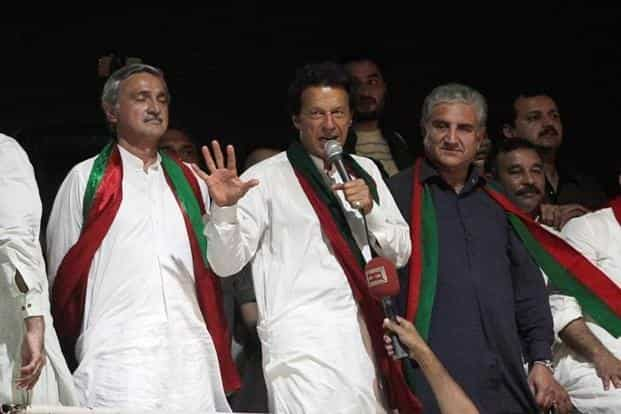 Imran Khan has vowed to contest orders banning public gatherings in court but has hinted his supporters would march on the capital next week regardless of what the judiciary decides. Photo: Reuters