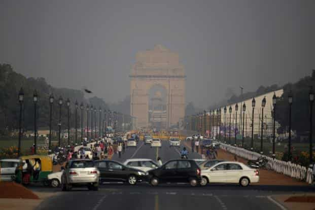 (Above) a thin layer of smog covered India Gate on Friday before the Diwali festival. Altaf Qadri/AP