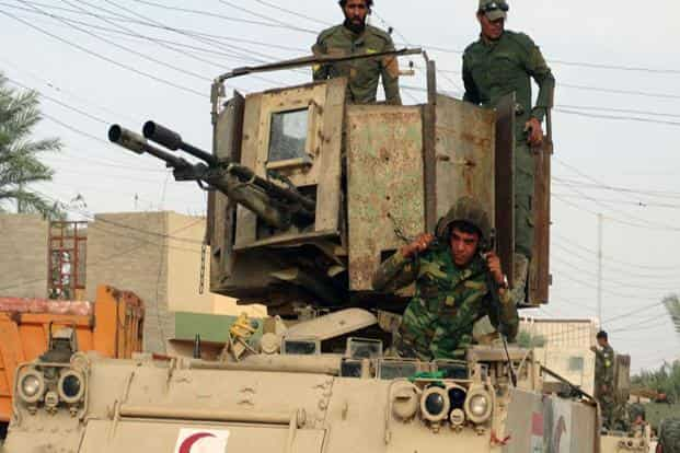 A file photo of Iraqi Shiite Hezbollah Brigade militiamen. Mosul is by far the largest city held by the ultra-hardline Sunni Islamic State and its loss would mark their effective defeat in Iraq, two years after their leader Abu Bakr al-Baghdadi declared a caliphate overlapping Iraq and Syria from the pulpit of a Mosul mosque. Photo: AP