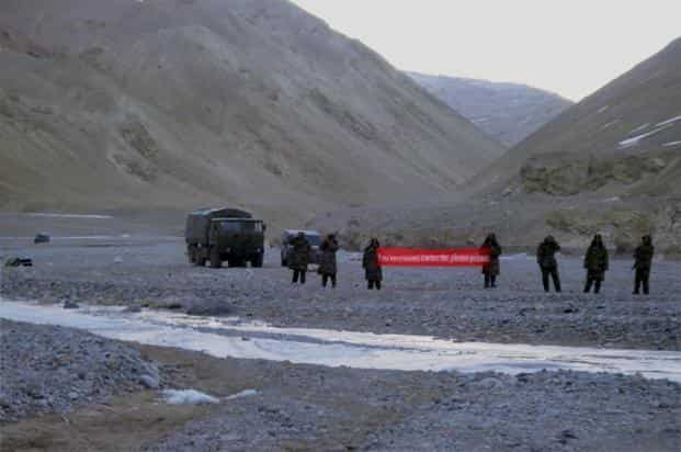 A file photo of intruding Chinese troops with a banner asking Indian soldiers to 'GO BACK' in Daulat Beg Oldi sector of Ladakh in 2013. Photo: PTI
