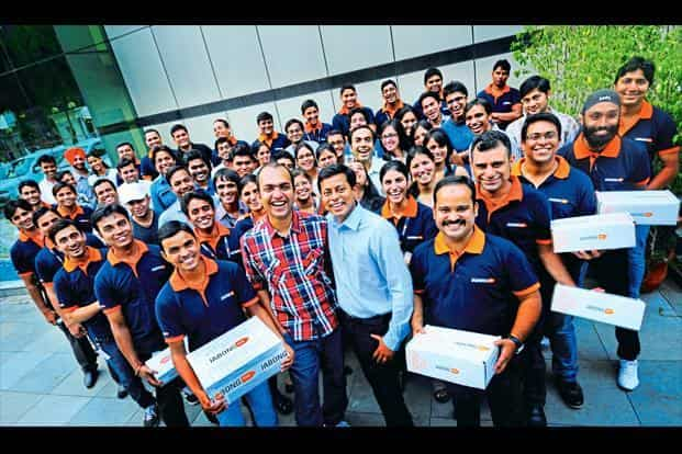 Jabong's Manu Kumar Jain and Praveen Sinha are flanked by employees in a file photo from 2012. Flipkart in July this year bought the online fashion retail firm from Global Fashion Group for $70 million. Photo: Priyanka Parashar/Mint