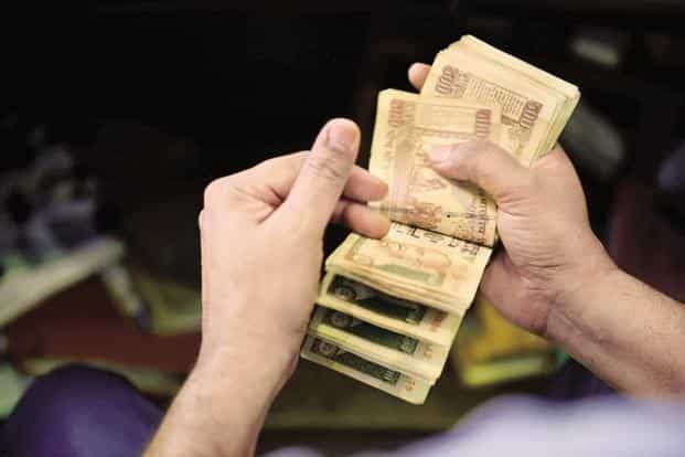 On Tuesday evening, Prime Minister Narendra Modi, in a surprise televised address, announced the government's move to weed out the menace of black money and counterfeit notes in circulation. Photo: Pradeep Gaur/Mint