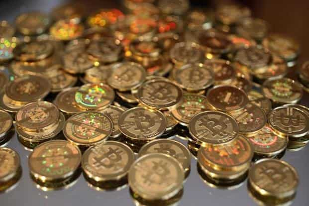 To buy bitcoins buyers would require to give their bank account details and undergo a know-your-customer process. Photo: AFP