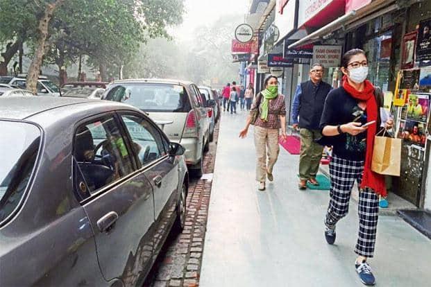 A masked shopper in Khan Market. Photographs: Mayank Austen Soofi