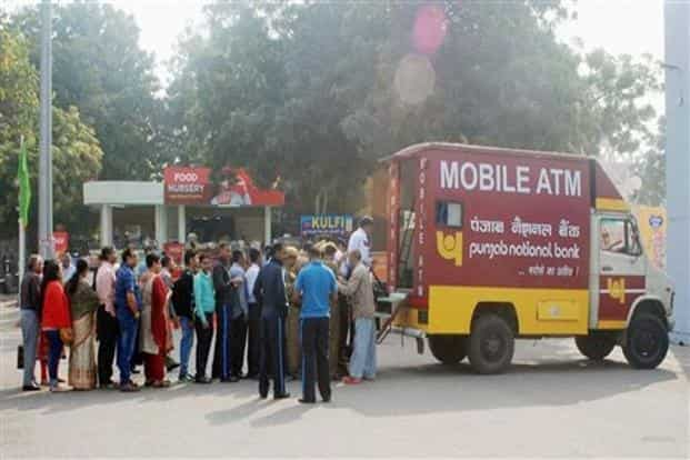 Most of the 2.20 lakh ATMs across the country are closed or partly functional, pushing the government for mobile ATMs. Photo: PTI