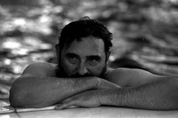 Castro relaxes in a swimming pool during a visit to Romania on 28 May 1972. Reuters