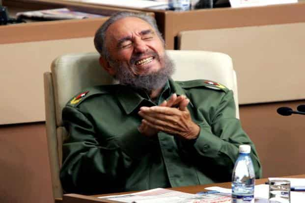 Then Cuban president Castro laughs during the year-end session of the Cuban parliament in Havana in this 23 December 2005 picture. Reuters