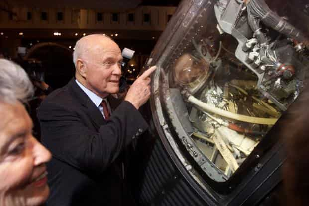 Former astronaut John Glenn shows the interior of his 'Friendship 7' Mercury spacecraft to wife Annie at the Smithsonian Air and Space Museum in Washington. Photo: Reuters