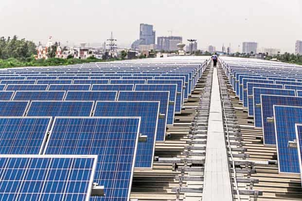 India has close to 9 GW of solar power capacity and domestic manufacturing capacity of about 6 GW of modules (panels) a year by close to 100 producers. Photo: Bloomberg