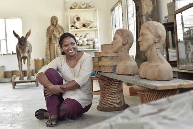 "Benitha Perciyal, 36: Born in Tiruvannamalai, Tamil Nadu, Benitha Perciyal's origins seep into the material she chooses to work with. ""I don't remember (using) anything plastic till I came to the city, says the artist, who uses only natural substances like coal, sand, leaf, incense and seeds, among other things, to create her art installations. SaiSen/Mint"