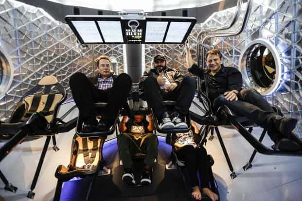 SpaceX CEO Elon Musk (left) inside the Manned Dragon V2 Space Taxi in Hawthorne, US. Photo: Patrick T. Fallon/Bloomberg