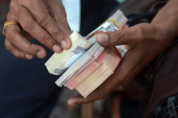 The rupee opened at 68.05 against the US dollar and touched a low of 68.25—a level last seen on 5 December. Photo: Mint