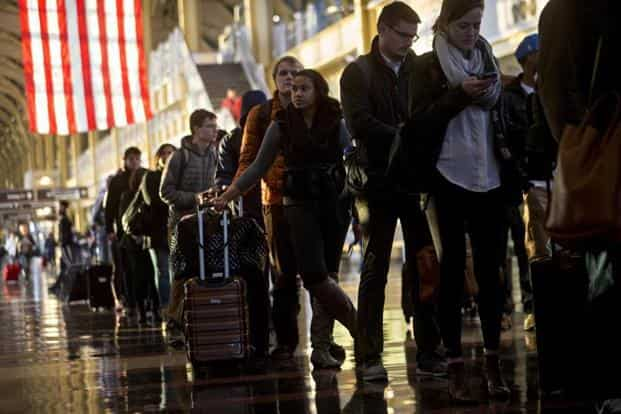 Travellers wait in line before going through Transportation Security Administration (TSA) screening at Ronald Reagan National airport (DCA) in US. Photo: Bloomberg