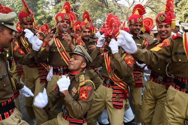 Border Security Force personnels dance as they wait to take part in a full-dress rehearsal for the forthcoming Republic Day parade in Kolkata on Tuesday. AFP
