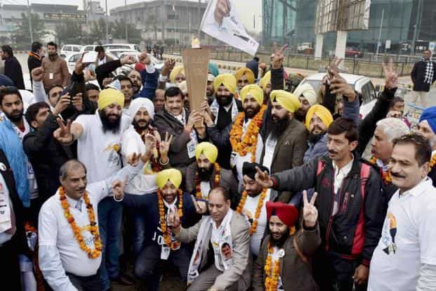 A file photo of AAP senior leader Sanjay Singh, other Punjab unit leaders holding the flame of hope in Amritsar. Photo: PTI