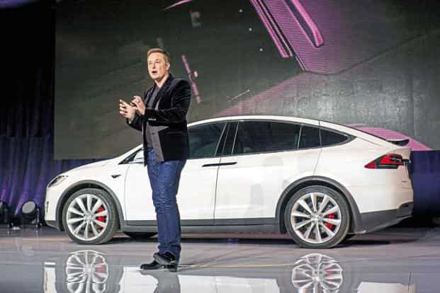 To a query on when Tesla would launch its vehicles in India, CEO Elon Musk tweeted  'Hoping for summer this year'. Photo: Bloomberg