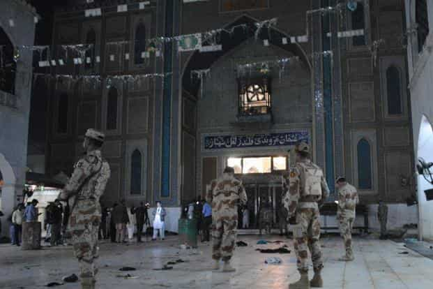Pakistani para-military soldiers stand alert after a deadly suicide attack at the shrine of famous Sufi Lal Shahbaz Qalandar in Sehwan. Photo: AP